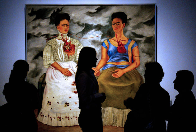 """People look at the 1939 painting """"Las Do"""